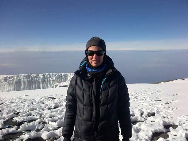 Kristen at Summit of Kilimanjaro