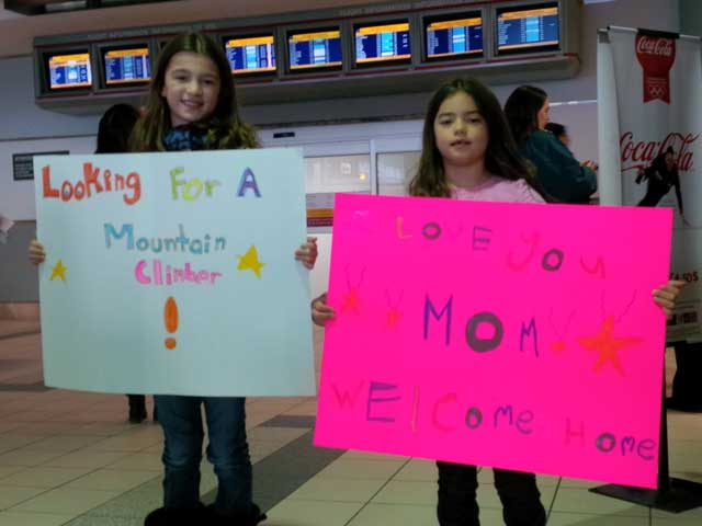 Kids Greet with Signs at Airport